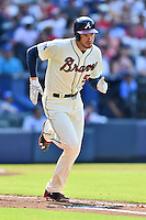 Atlanta Braves first baseman Freddie Freeman (5) runs to first during a game against the Chicago Cubs at Turner Field on June 11, 2016 in Atlanta, Georgia. The Cubs defeated the Braves 8-2. (Tony Farlow/Four Seam Images)