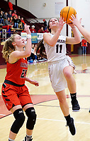 Westside Eagle Observer/RANDY MOLL<br /> Gentry's Ahrya Reding shoots under the basket during play against Farmington High School at Gentry on Jan. 14, 2020.