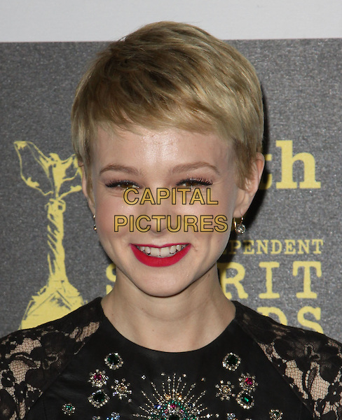 CAREY MULLIGAN .25th Annual Film Independent Spirit Awards held At The Nokia LA Live, Los Angeles, California, USA,.March 5th, 2010 ..arrivals Indie Spirit portrait headshot black dress lace beaded jewelled red lipstick make-up earrings cropped crop short hair embellished jewel encrusted smiling .CAP/ADM/KB.©Kevan Brooks/Admedia/Capital Pictures