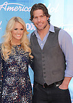 LOS ANGELES, CA - MAY 23: Carrie Underwood and Mike Fisher arrive at 'American Idol' Season 11 Grand Finale Show at Nokia Theatre L.A. Live on May 23, 2012 in Los Angeles, California.