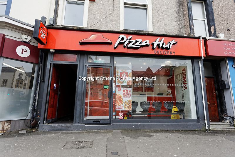Pictured: The Pizza Hut take away restaurant in St Helen's Road, Swansea, Wales, UK. Wednesday 17 APril 2019<br /> Re: A Pizza Hut outlet has been issued with an  immediate closure notice for public protection after inspectors found evidence of a mouse infestation in the premises, Swansea Magistrates court has heard.<br /> Environmental health officers found mouse droppings throughout the kitchen area of the property, as well as in the damp cellar where the pizza delivery boxes were stored.<br /> The franchise owners have been fined £8,000.<br /> The court heard inspectors carried out a routine inspection of the pizza delivery and takeaway premises on St Helen's Road in Swansea on the13th of March 2018.<br /> Milton Keynes-based Sania PH Ltd, had previously pleaded guilty to six offences under the Food Hygiene Wales Regulations before district judge Neale Thomas.<br /> Charges against the owner of the company, Mubarak Ali, 44 of  Milton Keynes, were dropped.<br /> The court heard Mr Ali's businesses run a total of 18 Pizza Hut franchises - nine in Wales and nine in England.