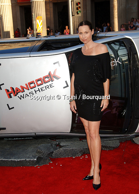 Minnie Driver  - <br /> Hancock LA premiere at the Chinese Theatre In Los Angeles.<br /> <br /> full length<br /> pregnante<br /> eye contact