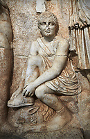 Close up of Roman Sebasteion relief  sculpture of Meleager and Atalante  Aphrodisias Museum, Aphrodisias, Turkey.    <br /> <br /> Meleager sits on a rock tying his sandal. Below him lies a fierce hunting dog with a broad collar. On one side a god or another hero wearing a rounded hat was crowning Meleager ( arm missing). On the other side stands the huntress Atalante, Meleager's lover: she wears a short dress and quiver, and lifts her cloak at the shoulder in a gesture of modesty.