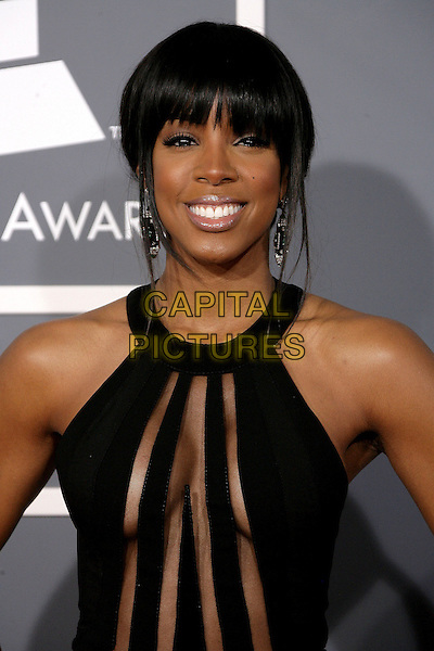 Kelly Rowland.The 55th Annual GRAMMY Awards held at STAPLES Center, Los Angeles, California, USA..February 10th, 2013.grammys half length black sleeveless dress sheer panels striped stripes cleavage headshot portrait fringe bangs hair.CAP/ADM.©AdMedia/Capital Pictures.