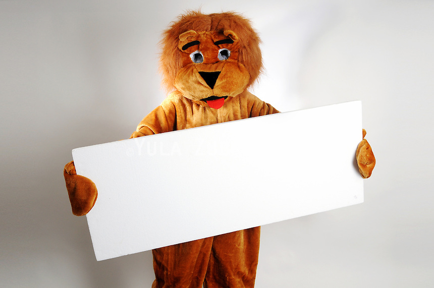 Purim Jewish holiday costume<br /> Lion with white empty sign<br /> Copy space