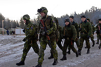 Kamenka, Karelia, Russia, 14/12/2007..Swedish and professional Russian soldiers during Snezhinka [Snowflake] 2007, a joint live fire training exercise for Russian and Swedish motorised infantry in which they play the roles of a combined peace-keeping force enforcing a demilitarised zone in a warring region.