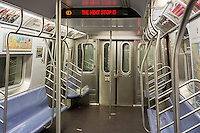 """An empty New York City Transit Authority subway car on the """"E"""" line, seen at its World Trade Center terminus on Sunday, January 12, 2014. (© Richard B. Levine)"""