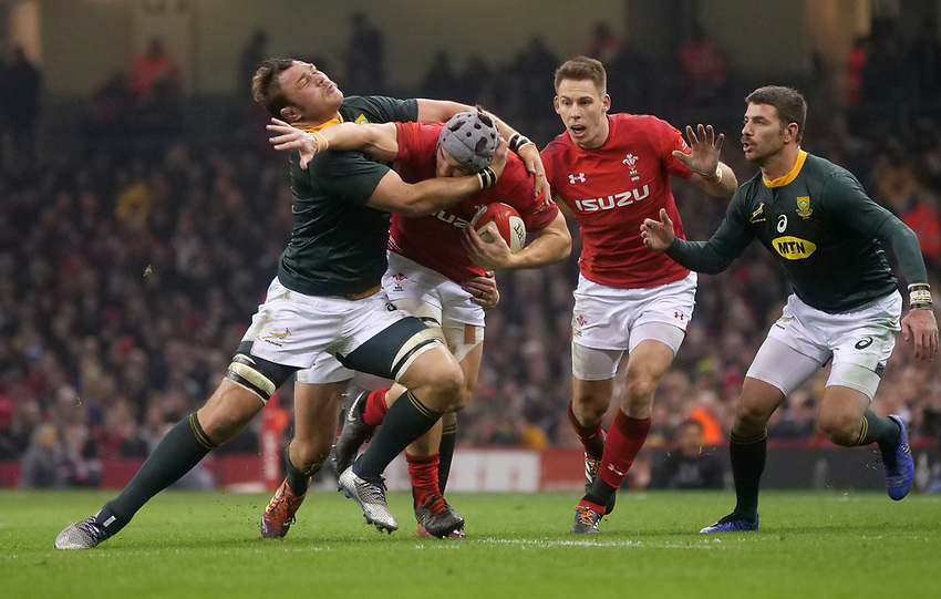 Wales' Jonathan Davies is tackled by South Africa's Duane Vermeulen<br /> <br /> Photographer Ian Cook/CameraSport<br /> <br /> Under Armour Series Autumn Internationals - Wales v South Africa - Saturday 24th November 2018 - Principality Stadium - Cardiff<br /> <br /> World Copyright © 2018 CameraSport. All rights reserved. 43 Linden Ave. Countesthorpe. Leicester. England. LE8 5PG - Tel: +44 (0) 116 277 4147 - admin@camerasport.com - www.camerasport.com
