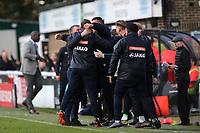 Dover Manager, Andy Hessenthaler celebrates with his coaching team at the final whistle as Southend Manager, Sol Campbell heads to the dressing room during Dover Athletic vs Southend United, Emirates FA Cup Football at the Crabble Athletic Ground on 10th November 2019