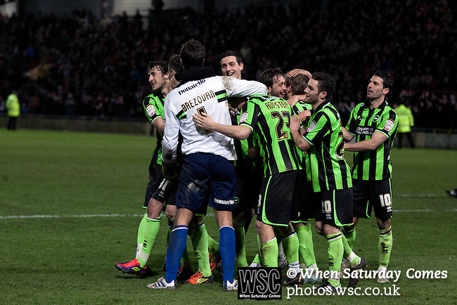 Wrexham 1 Brighton & Hove Albion 1, 18/01/2012. Racecourse Ground, FA Cup 3rd Round Replay. Brighton and Hove Albion players celebrating after the penalty shoot out against Wrexham in an FA Cup third round replay, at the Racecourse Ground played following the teams one-all draw in the first match. The replay was won by Brighton, 5-4 on penalty kicks after the match had ended in a one-all draw after extra time, watch by a crowd of 8316. The visitors played in the Championship, three leagues above their rivals from Wales, who were top of the Conference at the time of the match. Photo by Colin McPherson.