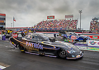 Apr 27, 2014; Baytown, TX, USA; NHRA funny car driver Alexis DeJoria (near) races alongside Robert Hight during the Spring Nationals at Royal Purple Raceway. Mandatory Credit: Mark J. Rebilas-USA TODAY Sports