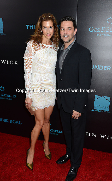 Alysia Reiner and David Alan Basche attend the Special Screening of &quot;John Wick&quot;  on October 13, 2014 at the Regal Union Square Stadium 14 in New York City.<br /> <br /> photo by Robin Platzer/Twin Images<br />  <br /> phone number 212-935-0770