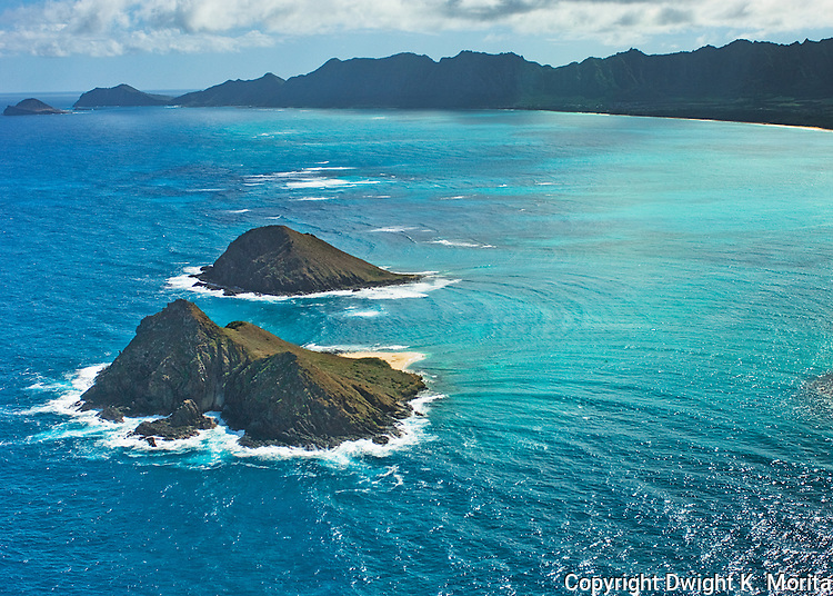 Aerial view of the Mokulua Islands in the early afternoon light. Makapu'u point and Rabbit Island in the background