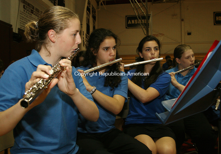 TORRINGTON,CT- 14 JUNE 2006 061406EM02- . Rachel Pelchat, Maura Magistrali, Allie Munson, Lindsay Stone play flute for the Seventh & Eight  Grade Symphonic Band during a district wide concert at Torrington High School. Ed Messenger Republican-American