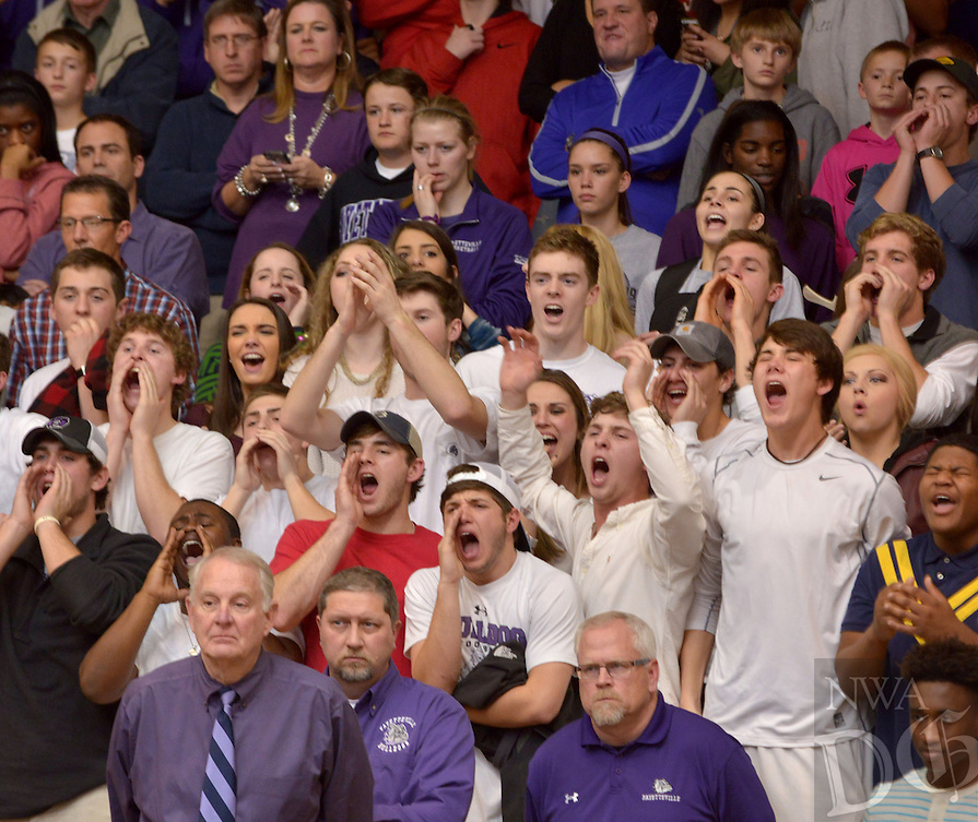 NWA Democrat-Gazette/BEN GOFF -- 01/30/15 The Fayetteville student section cheers during the Fayetteville takes vs Bentonville boys' game in Bentonville's Tiger Arena on Friday, Jan. 30, 2015.