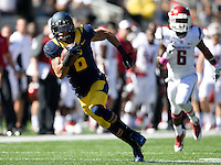 Chris Harper of California runs the ball to the end zone to score a touchdown during the game against Washington State at Memorial Stadium in Berkeley, California on October 5th, 2013.  Washington State defeated California, 44-22.