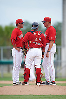 GCL Red Sox pitching coach Dick Such (34) talks with relief pitcher Jared Oliver (46) and catcher Alberto Schmidt (41) during the second game of a doubleheader against the GCL Rays on August 9, 2016 at JetBlue Park in Fort Myers, Florida.  GCL Rays defeated GCL Red Sox 9-1.  (Mike Janes/Four Seam Images)
