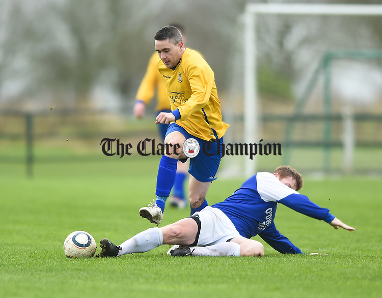 Eoin Hayes of Clare in action against Tom Clarke of Limerick during their FAI Oscar Traynor game in Limerick. Photograph by John Kelly.