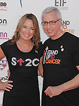 LOS ANGELES, CA - SEPTEMBER 07: Dr. Drew Pinsky and Susan Pinsky arrive at Stand Up To Cancer at The Shrine Auditorium on September 7, 2012 in Los Angeles, California.
