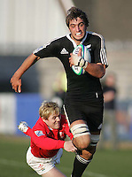 New Zealand second row Samuel Whitelock battles for the line during the Division A clash at Ravenhill. Result New Zealand 37 Wales 14.