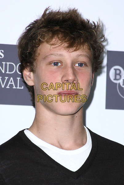 "GEORGE MACKAY.At the Times BFI 53rd London Film Festival Photocall for ""The Boys Are Back"" at the Mayfair Hotel, London, England, UK, October 21st 2009..portrait headshot white black jumper sweater.CAP/JIL.©Jill Mayhew/Capital Pictures"