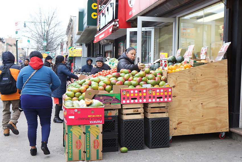 BROOKLYN, NY - JANUARY 16, 2016: Shoppers pick through produce at La Vaquita on 5th Avenue. <br /> LOCATION: 5th Avenue between 47th and 48th Streets.<br /> CREDIT: Clay Williams for the New York Times.<br /> <br /> &copy; Clay Williams / claywilliamsphoto.com