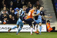 Matthew Bloomfield of Wycombe Wanderers (right) stops Oliver Lee of Luton Town (centre) during a Luton Town attack during the Sky Bet League 2 match between Luton Town and Wycombe Wanderers at Kenilworth Road, Luton, England on 26 December 2015. Photo by David Horn.