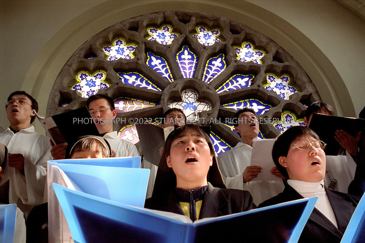 12/1/12004--Shanghai, China..Young Chinese nuns take their vow of celibacy at the Xinjuhui Catholic Church in Shanghai...Photograph by Stuart Isett.©2004 Stuart Isett. All rights reserved