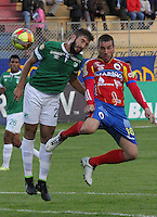 PASTO -COLOMBIA, 13-09-2014. Ramirez Forste (Der) jugador del  Deportivo Pasto disputa un balón con Janer Torijano (Der) jugador del Deportivo Cali por la fecha 9 Liga Postobón II 2014 jugado en el estadio La Libertad de Pasto./ Ramirez Forste (R) player of Deportivo Pasto vies for the ball with Janer Torijano (L) player of Deportivo Cali for the 9th date of Postobon  League II 2014 played at La Libertad stadium in Pasto. Photo: VizzorImage / Leonardo Castro / STR