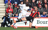 Modou Barrow of Swansea City is tackled by Charlie Daniels of Bournemouth during the Barclays Premier League match between AFC Bournemouth and Swansea City played at The Vitality Stadium, Bournemouth on March 11th 2016
