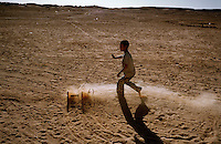 The Saharawi refugee camp  Smara..Sahrawi  child playing in the desert.January 2008