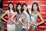 Customers pose for the cameras during the ''Seminaked in Red'' event at Desigual Harajuku store on June 27, 2015, Tokyo, Japan. Spanish fashion label's promotional event offered the first 100 participants who arrived wearing swimsuits a discount on all in store items. According to the organizers around 100 people lined up over night despite the heavy rain. (Photo by Rodrigo Reyes Marin/AFLO)