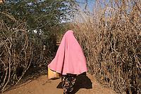 Kenya - Dadaab - A Somali refugee fetching water in Ifo camp.