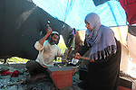 Palestinian blacksmith Ibraheem Mustafa, 40-year-old, with his wife, hammer heated steel to shape a knife, at their small workshop in Gaza city on April 30, 2015. The ILO estimates that the 2014 conflict in Gaza raised unemployment from 32.6 per cent to 36.9 per cent, which caused an estimated daily loss in economic activity of US$ 508,000 per working day since August 2014. As the numbers of the unemployed laborers in Gaza reached 200,000 and poverty to 60 per cent, according to local reports. Photo by Ashraf Amra