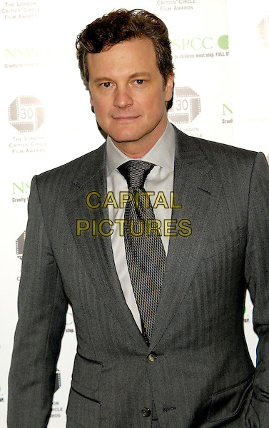 COLIN FIRTH .The London Critics' Circle Film Awards.at The Landmark Hotel, London, England, 18th February 2010..half length suit jacket grey gray shirt tie . CAP/CJ.©Chris Joseph/Capital Pictures