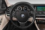 Car pictures of steering wheel view of a 2015 BMW SERIES 5 ActiveHybrid 5 Luxury 4 Door Sedan Steering Wheel