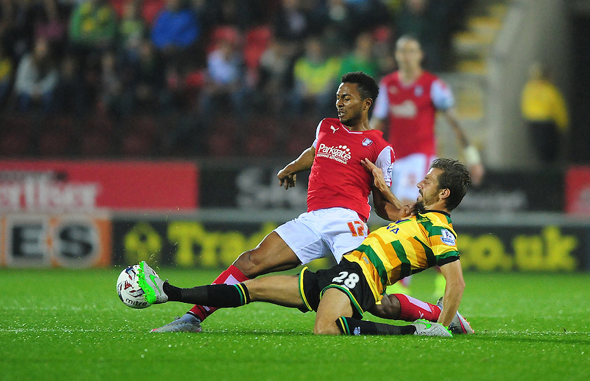 Rotherham United's Grant Ward is fouled by Norwich City's Gary O'Neil<br /> <br /> Photographer Chris Vaughan/CameraSport<br /> <br /> Football - Capital One Cup Second Round - Rotherham United v Norwich - Tuesday 25th August 2015 - New York Stadium - Rotherham<br />  <br /> &copy; CameraSport - 43 Linden Ave. Countesthorpe. Leicester. England. LE8 5PG - Tel: +44 (0) 116 277 4147 - admin@camerasport.com - www.camerasport.com