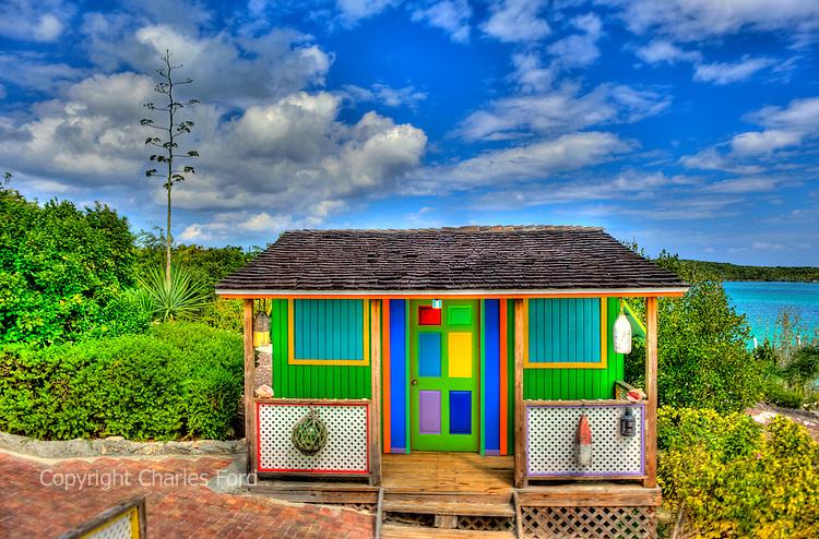 Colorful shack under brilliant blue Caribbean sky in the Bahamas.