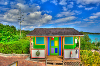 Colorful shack under brilliant blue Caribbean sky in the Bahamas.
