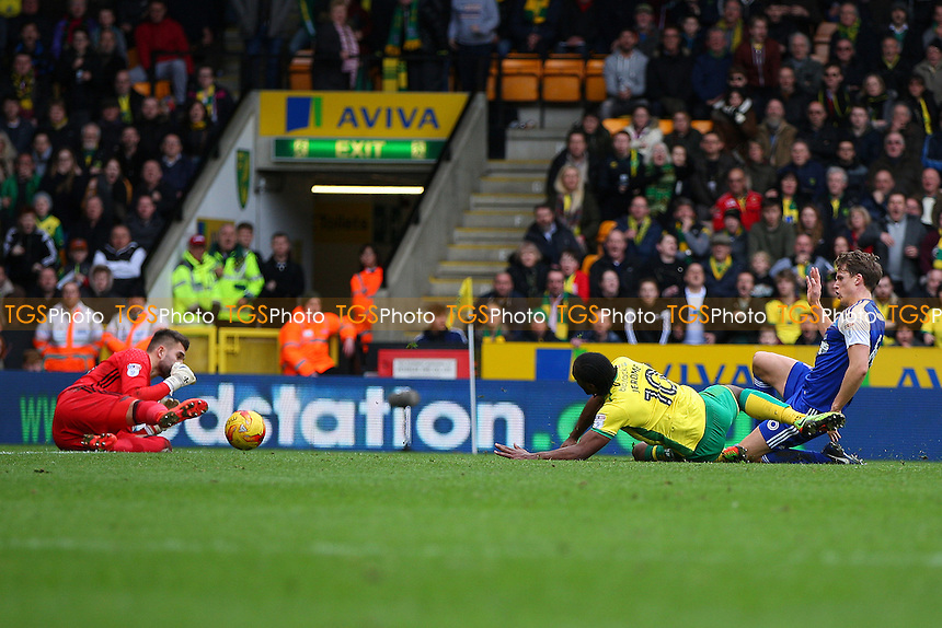 Cameron Jerome of Norwich City goes down in the box under a challenge from Christophe Berra of Ipswich Town during Norwich City vs Ipswich Town, Sky Bet EFL Championship Football at Carrow Road on 26th February 2017