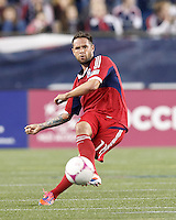 Chicago Fire midfielder Daniel Paladini (11) passes the ball. In a Major League Soccer (MLS) match, the New England Revolution (blue) defeated Chicago Fire (red), 1-0, at Gillette Stadium on October 20, 2012.