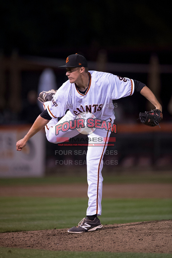 San Jose Giants relief pitcher Jeff Burke (51) follows through on his delivery during a California League game against the Modesto Nuts at San Jose Municipal Stadium on May 15, 2018 in San Jose, California. Modesto defeated San Jose 7-5. (Zachary Lucy/Four Seam Images)