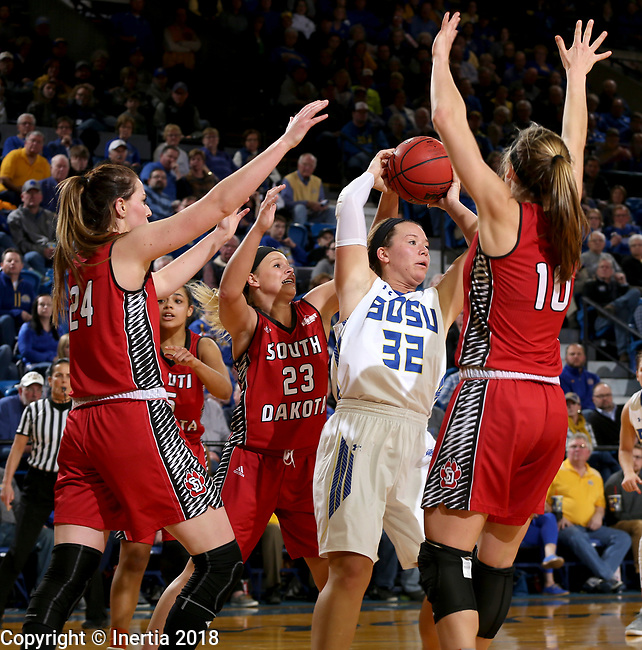 BROOKINGS, SD - JANUARY 25: Sydney Palmer #32 from South Dakota State University looks for help while being surrounded by Ciara Duffy #24, Madison McKeever #23, and Allison Arens #10 from the University of South Dakota during their game Thursday night at Frost Arena in Brookings. (Photo by Dave Eggen/Inertia)