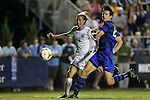 19 September 2014: North Carolina's Andy Craven (10) takes a shot past Duke's Markus Fiortoft (NOR) (right). The Duke University Blue Devils hosted the University of North Carolina Tar Heels at Koskinen Stadium in Durham, North Carolina in a 2014 NCAA Division I Men's Soccer match. Duke won the game 2-1.