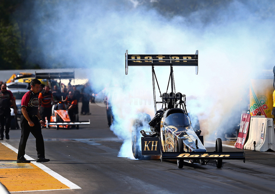 Aug. 17, 2013; Brainerd, MN, USA: NHRA top fuel dragster driver Khalid Albalooshi during qualifying for the Lucas Oil Nationals at Brainerd International Raceway. Mandatory Credit: Mark J. Rebilas-