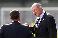 Portsmouth FC Owner, Michael Eiser in conversation with a colleague ahead of kick-off during AFC Wimbledon vs Portsmouth, Sky Bet EFL League 1 Football at the Cherry Red Records Stadium on 13th October 2018