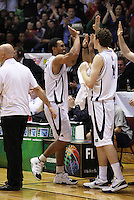 Tall Blacks forward Mike Vukona is welcomed off the court near the end of the final quarter during the International basketball match between the NZ Tall Blacks and Australian Boomers at TSB Bank Arena, Wellington, New Zealand on 25 August 2009. Photo: Dave Lintott / lintottphoto.co.nz