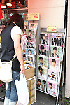 July 23, 2010 - Tokyo, Japan - A Japanese woman looks at commercial posters featuring South Korean celebrities, near JR Shin-okubo station in Tokyo, Japan, on July 23, 2010. Japanese fans of South Korean actor and singer Park Yong-ha, who commits suicide on June 30th, visited a memorial altar set up at a Korean restaurant in Tokyo's Okubo district, where many Koreans live.