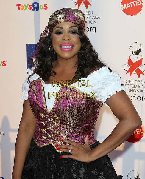 NIECY NASH .17th Annual Dream Halloween to benefit the Children Affected by Aids Foundation held at Barker Hanger,  Santa Monica, CA, USA, .30th October 2010..half length pink white shirt corset hand on hip head scarf pirate costume outfit dressed up  .CAP/ADM/KB.©Kevan Brooks/AdMedia/Capital Pictures.