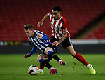 Kean Bryan of Sheffield Utd tackles Ben Hughes of Sheffield Wednesday during the Professional Development League match at Bramall Lane, Sheffield. Picture date: 26th November 2019. Picture credit should read: Simon Bellis/Sportimage